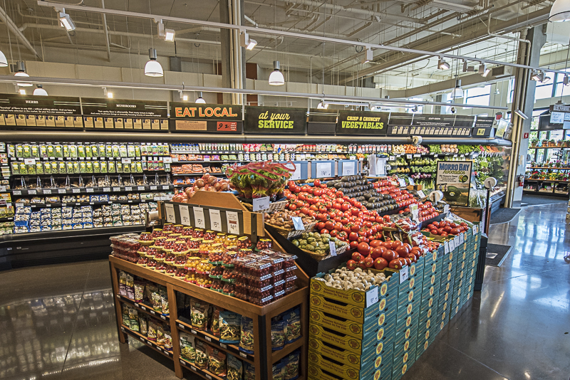 an island of tomatoes in the produce section.