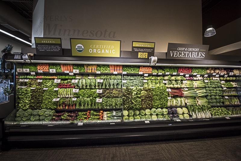 A shelf full of vegetables.