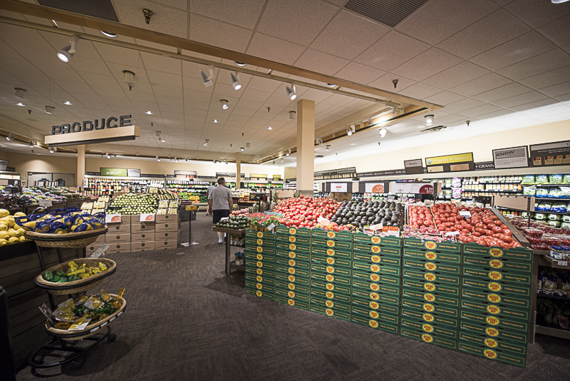 A produce section with carpeted floor.